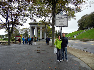 Skyler and Pattie under the Plymouth Rock sign in Plymouth, Massachusetts