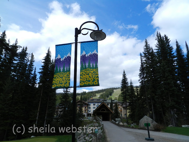 The path from the golf course leads across the covered walking bridge to the village of Sun Peaks.