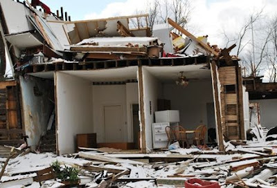 House destroyed by tornado exposed living quarters