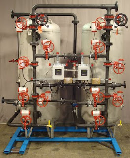 Res-Kem stainless steel sodium cycle condensate polisher with Bray valves, Bray actuators, flanged piping and skid mounting.