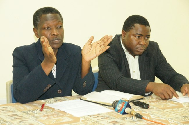 Head of the Government Communication Unit (President's Office, Planning Commission), Ms. Joyce Mkinga (Left) briefs journalists (not in the picture) on the Annual Planners' Conference to be held on the next month. Right is President's Office, Planning Commission's Principal Economist, Mr. Omary Juma.