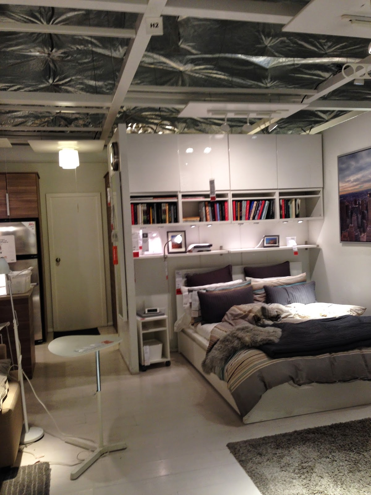 the showrooms in ikea are FULL of room vignettes where cabinets are mounted  above beds  sitting areas  desk areas and even eating areas  every inch is  used. design dump  3 things you can learn from an ikea showroom