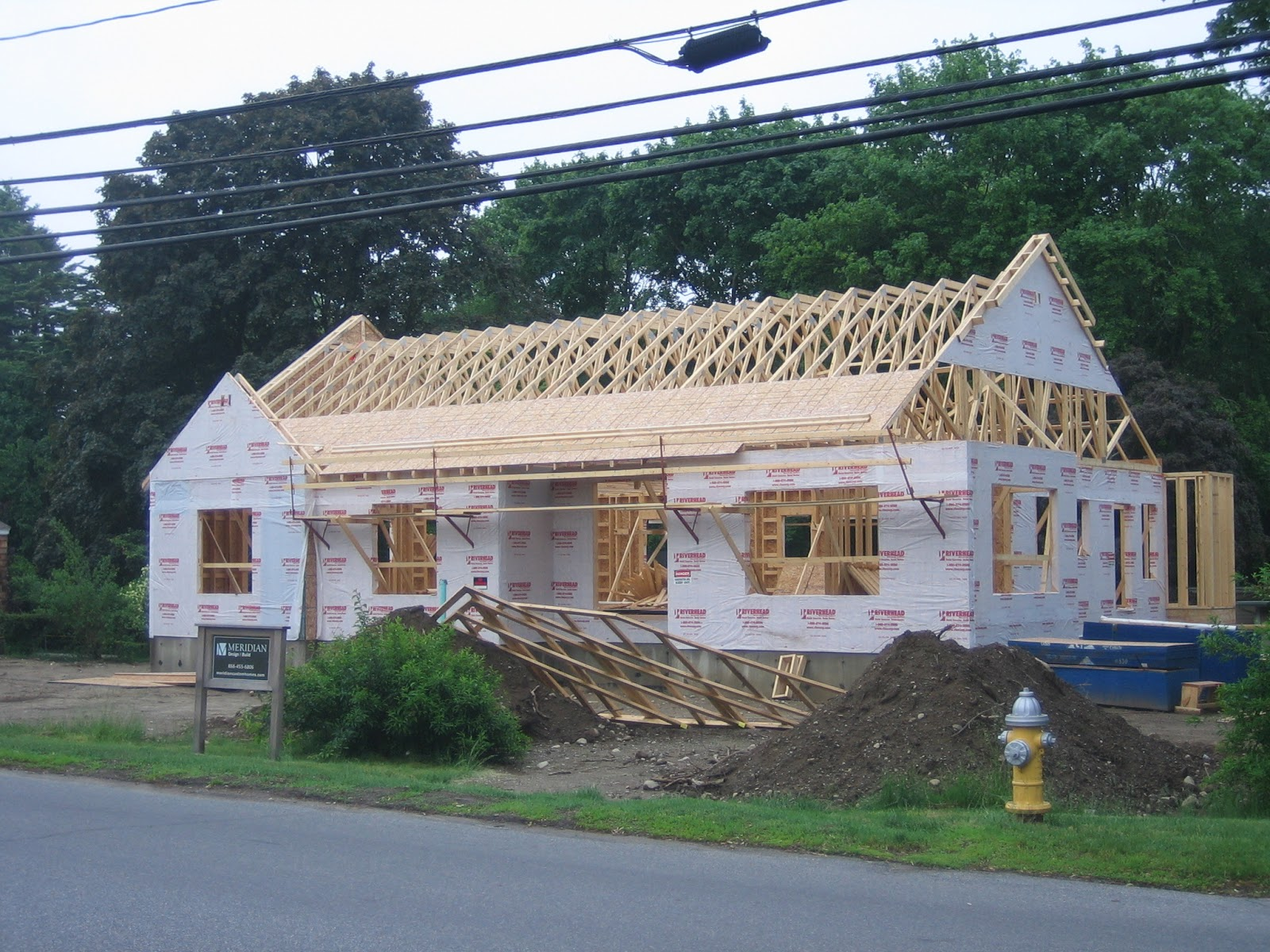 The impatient home builder wrapping up the roof for What is roof sheathing definition