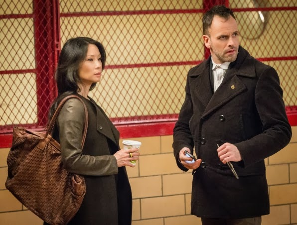 Jonny Lee Miller and Lucy Liu as Sherlock Holmes and Joan Watson in CBS Elementary Season 2 Episode 17 Ears To You