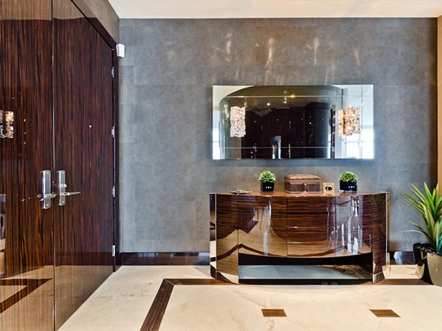 Picture of shiny modern dark brown furniture in the luxury bathroom