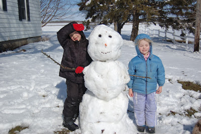 farm kids with April snowman