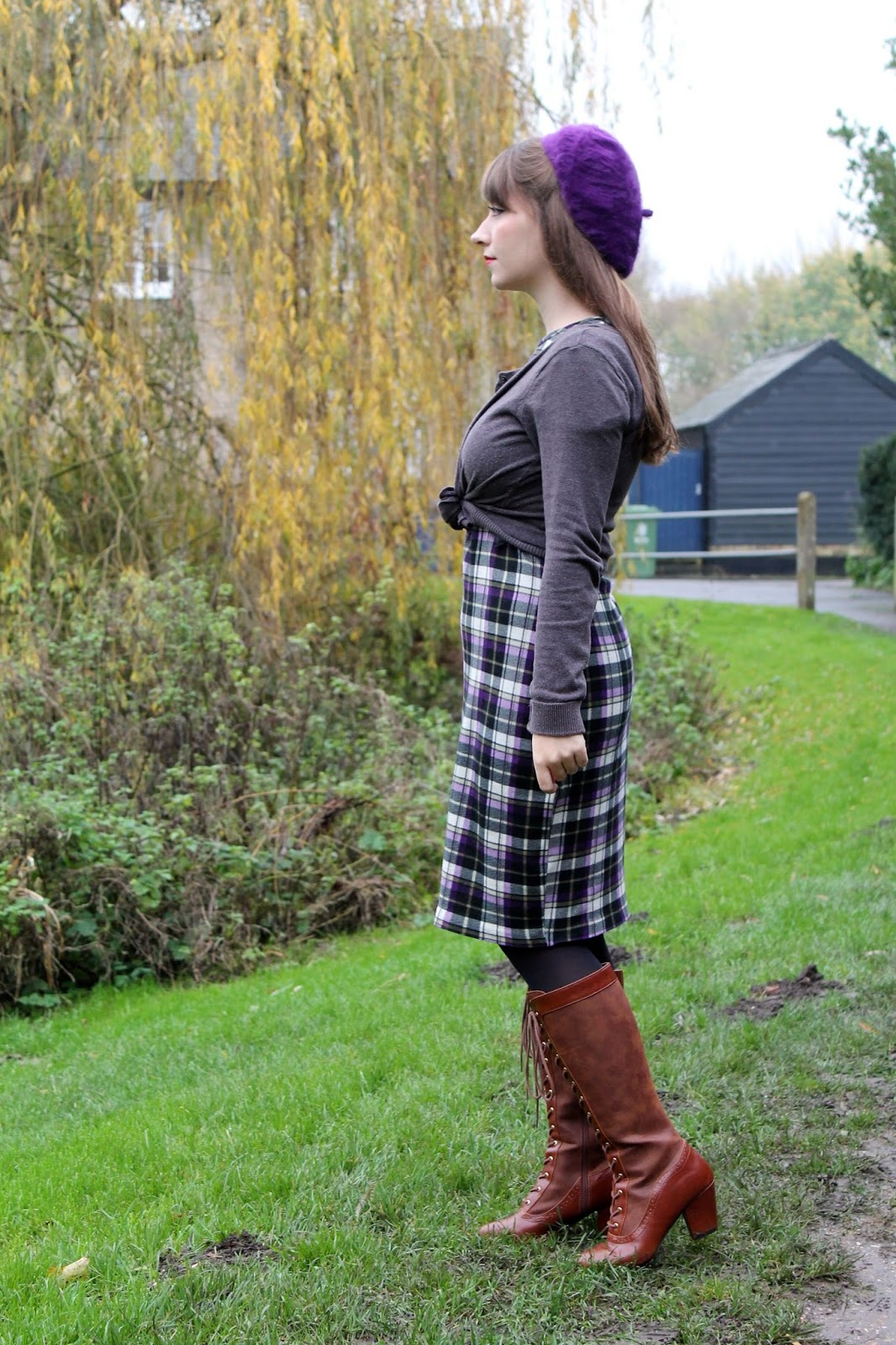 Plaid wiggle dress, cropped cardigan and knee-high boots