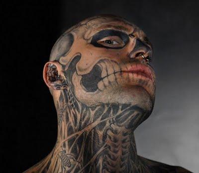 skull face tattoo. dragon skull tattoos.