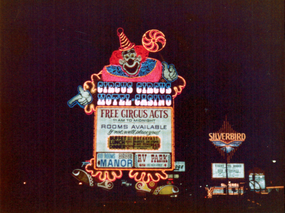 Circus Circus casino clown sign at night in Las Vegas 1980