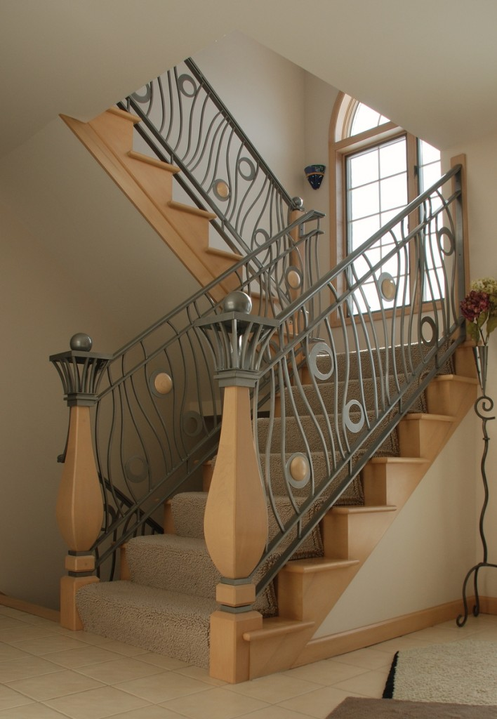Home interior decorating modern homes iron stairs railing for Interior iron railing designs