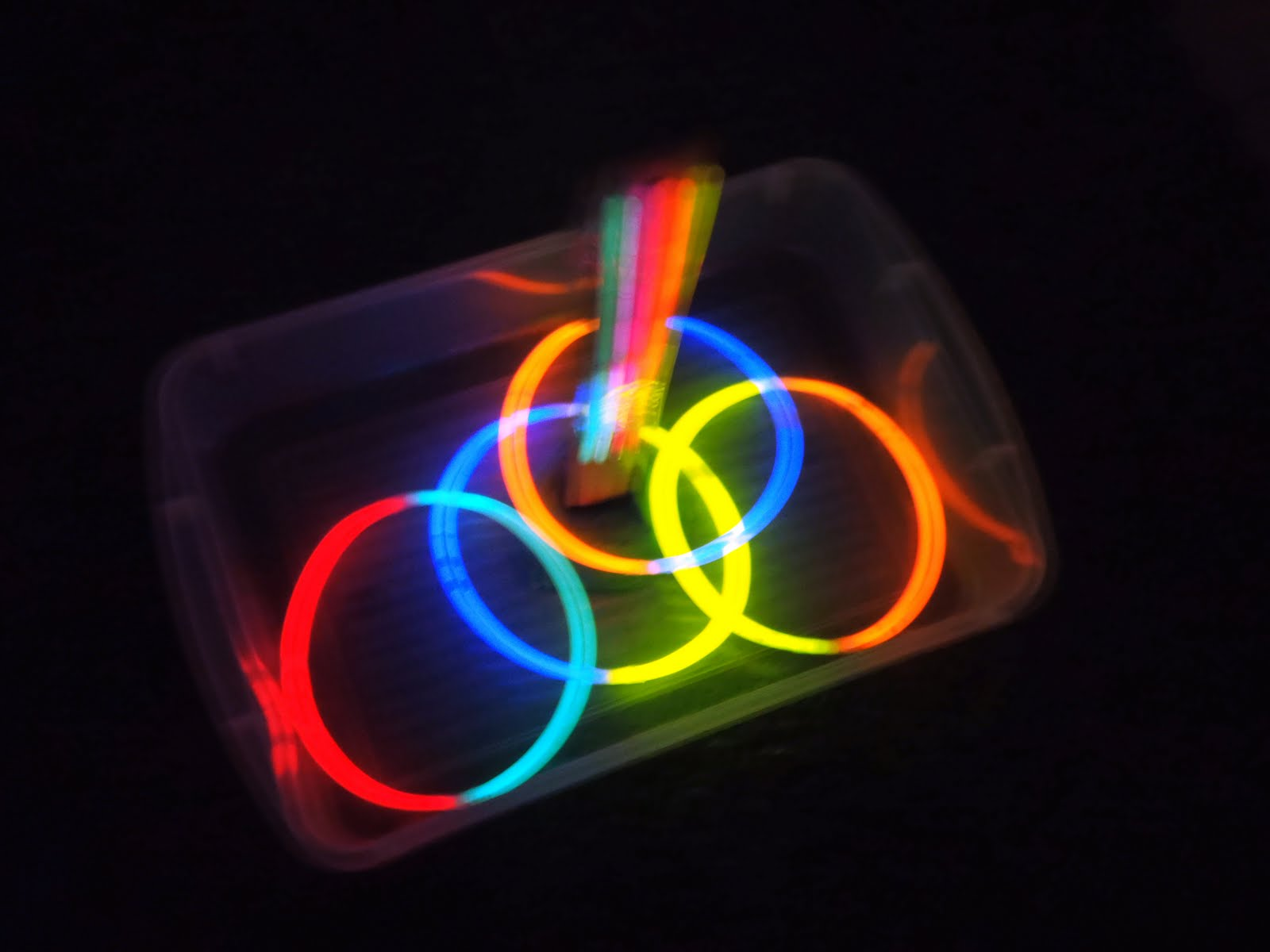 A Little Learning For Two: Glow In The Dark Ring Toss on glow stick craft ideas, glow sticks in water, glow stick outdoor ideas, fun with glow sticks ideas, glow stick costume ideas, glow stick game ideas, glow stick decorating ideas, glow sticks in balloons, glow sticks in the dark, glow stick centerpiece ideas, glow stick party decoration ideas, led lighting ideas, 10 awesome glow stick ideas, glow in the dark ideas, glow sticks cool,