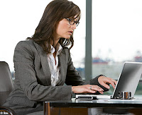 Buisness woman at the desk office with computet