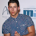 NICK JONAS SHOWS OFF HUGE BICEPS AT THE MICHAEL JORDAN CELEBRITY INVITATIONAL GALA 2014