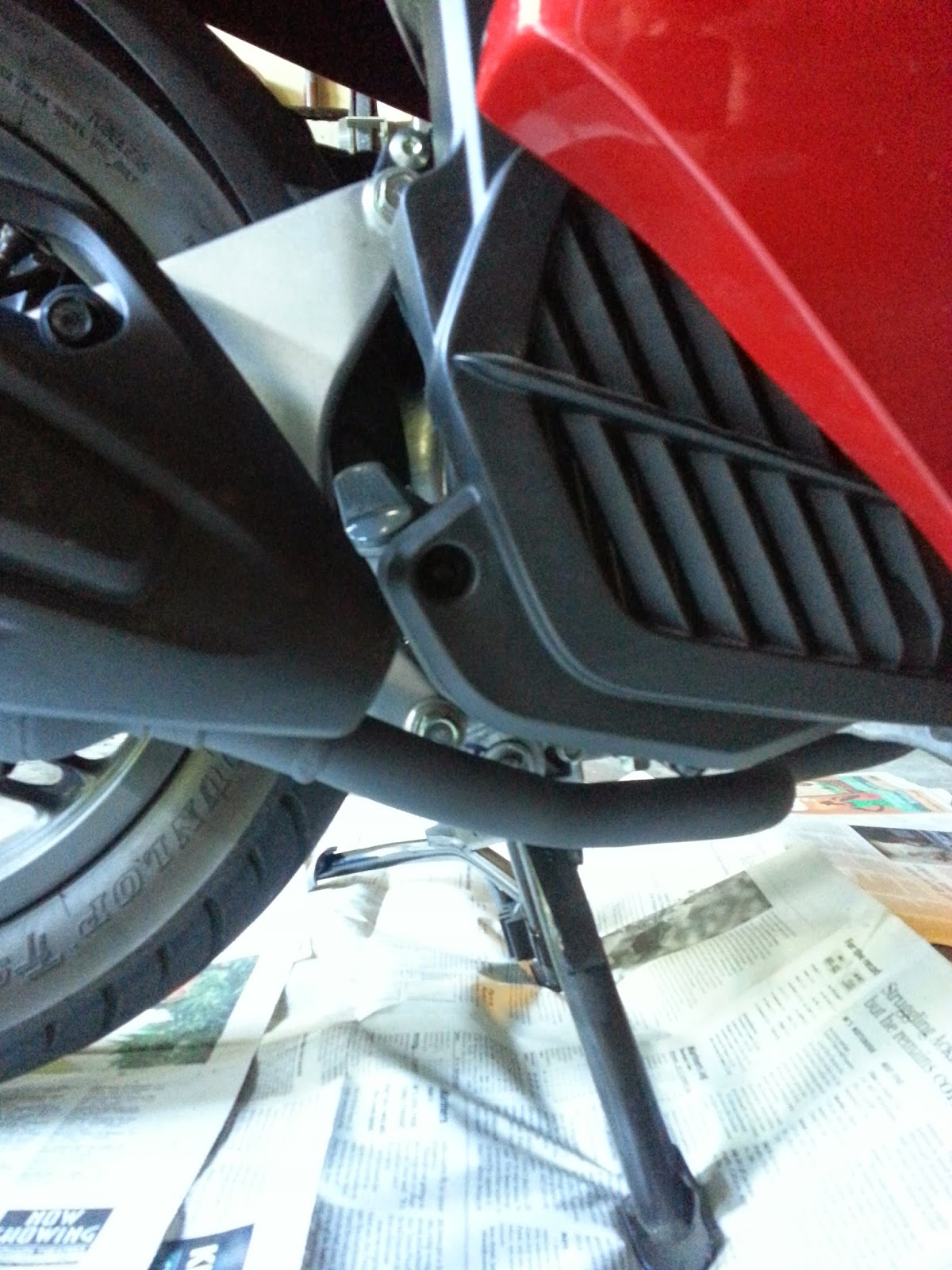 The oil drain plug and oil fill plug on are the side where the exhaust pipe is routed back and away from the engine on the right side of the pcx