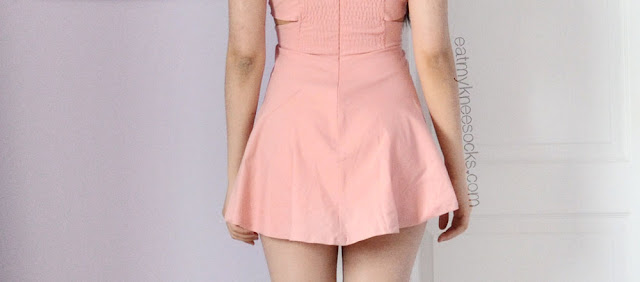 The back of the pink cutout skater dress from Romwe features a ruched design and invisible zipper.