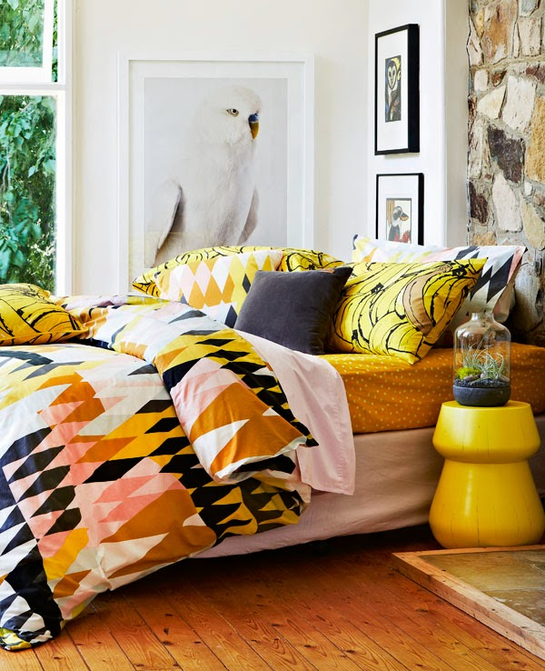 yellow bedroom decor. mixtures of patterns and colors