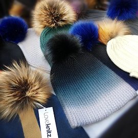 LoveKnitz cashmere beanies with fur pom poms.