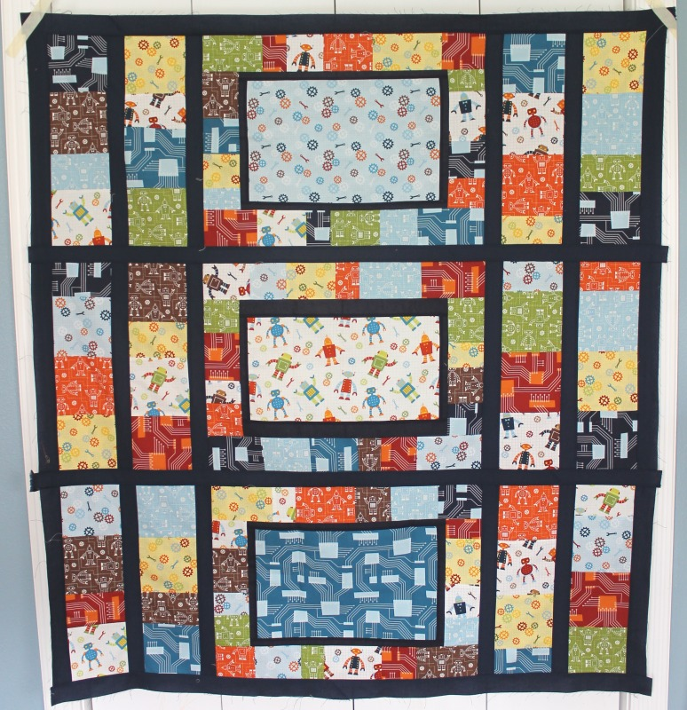 All twisted up robot factory quilt for cael for Robot quilt fabric