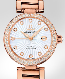Montre Omega Ladymatic or rouge référence 425.65.34.20.55.001