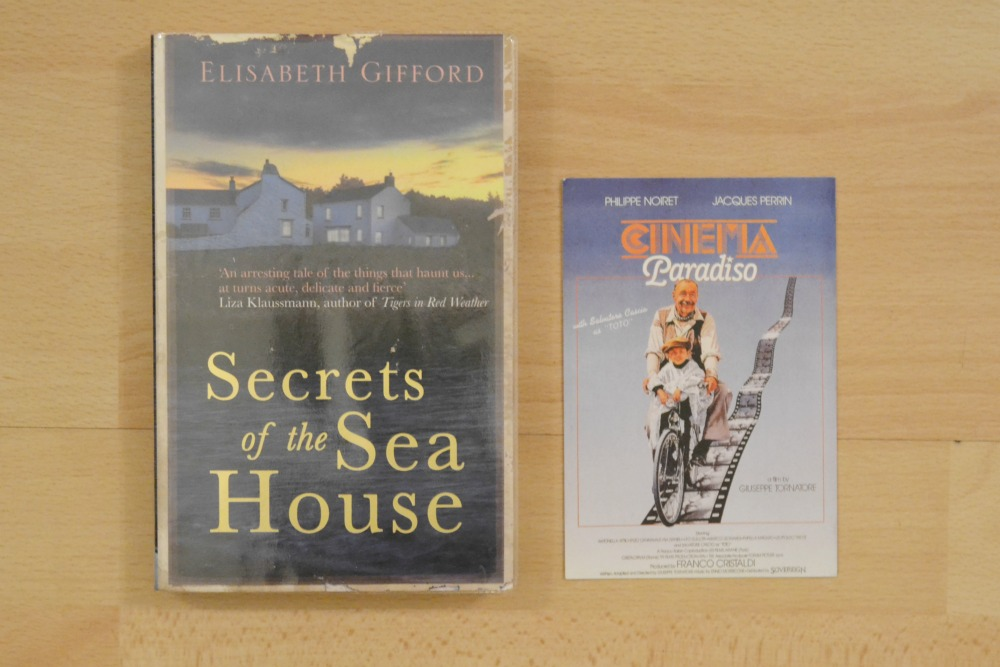 library book secrets of the sea house paperback cinema paradiso postcard