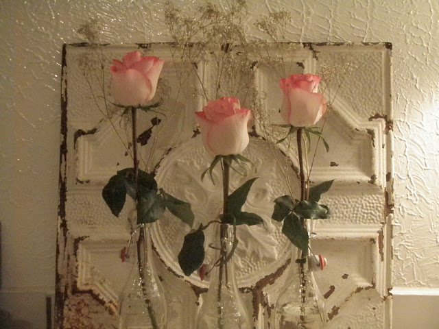 Roses with tin ceiling tile backdrop