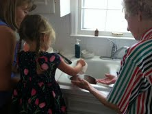 preschooler cooking with grandma