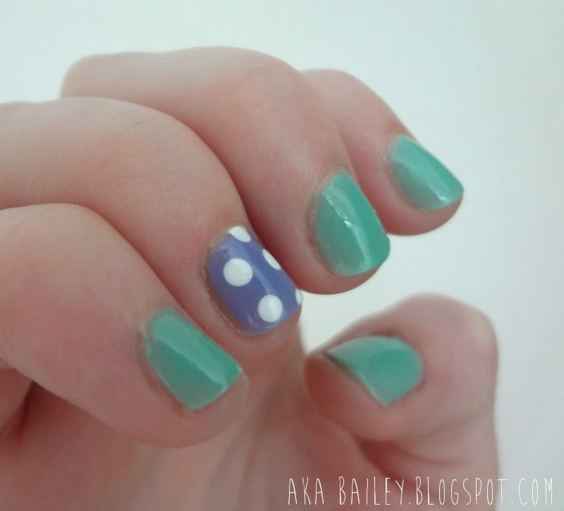 Turquoise and blue polka dot nails