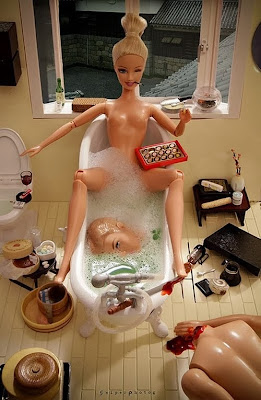 Funny psycho killer Barbie in the bath image with headless Ken