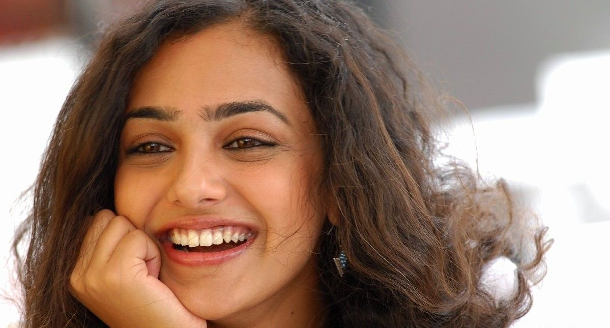 Nithya Menon Latest Movie stills,Gallery | Thuppaki songs download ...