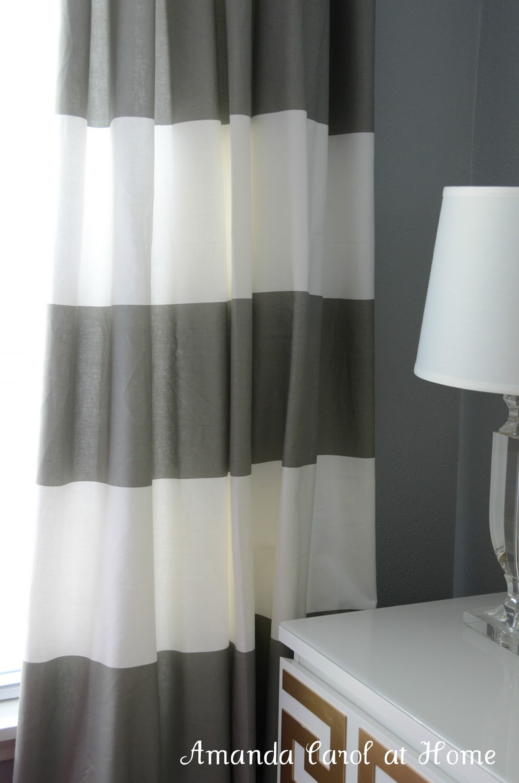 gray and white striped shower curtain. Not too shabby for  90 I even have left over fabric to make a pillow if wanted The only down side of this is there are two colors curtain Amanda Carol Interiors
