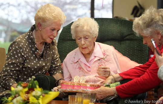 Blowing out the candles: L-R: Karin Campbell, Havelock North, only daughter of Rona McCarthy, Mary Doyle Trust Lifecare, Havelock North, who celebrated her 99th birthday photograph