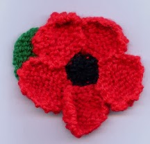 Knitted poppy made by Ingleby Barwick Knitting Group