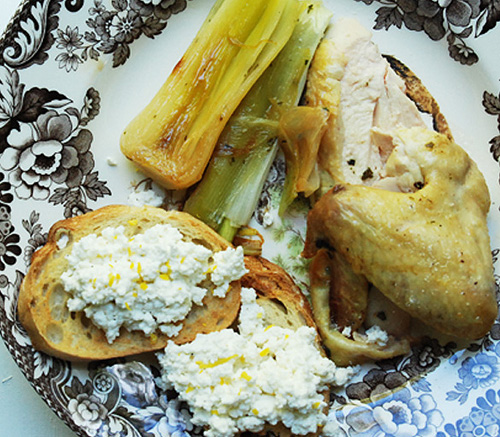 ... butter roasted chicken, braised leeks and warm lemon zest farm cheese
