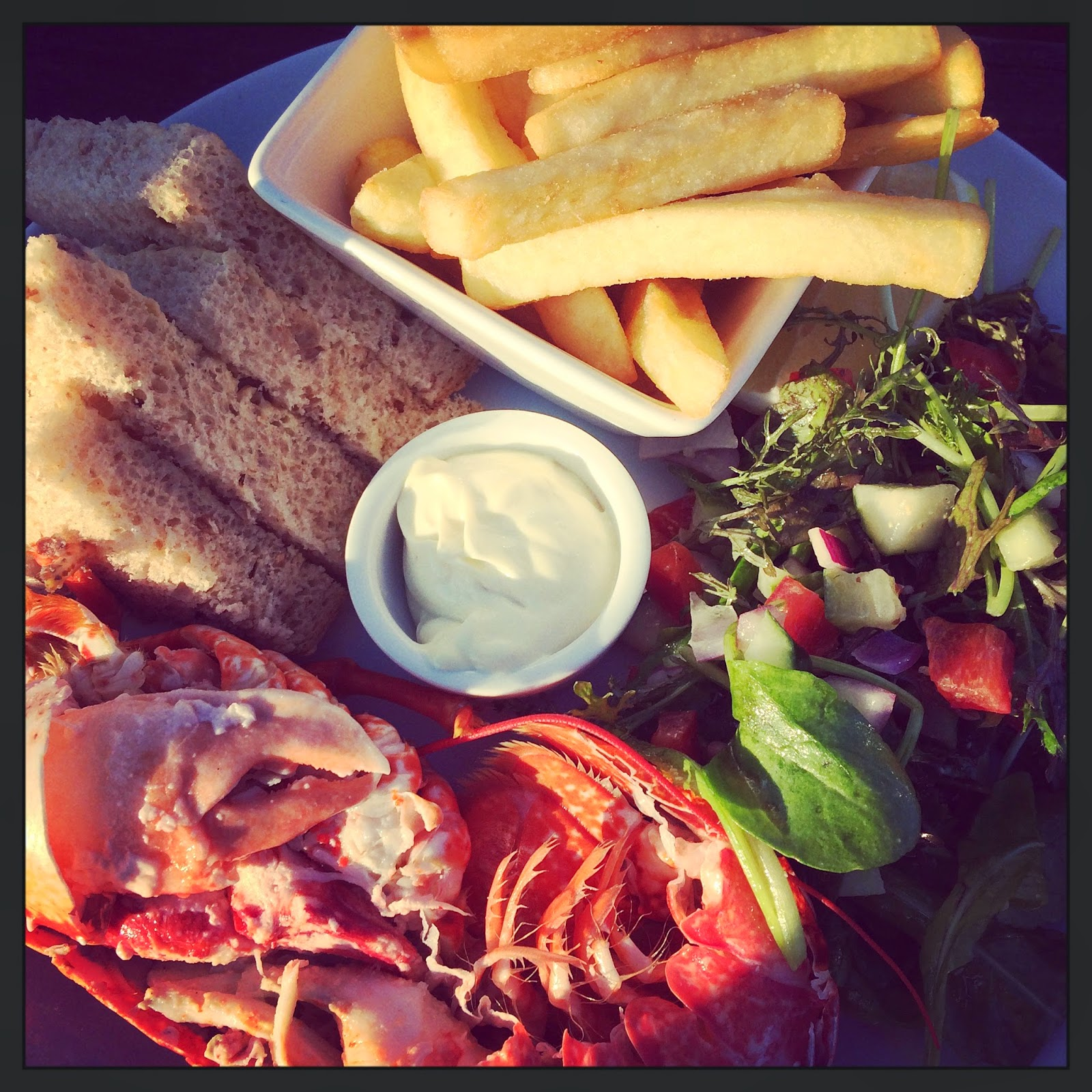 dressed lobster with salad, chips, granary bread and lemon mayo