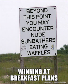 nude sunbathers eating waffles warning sign