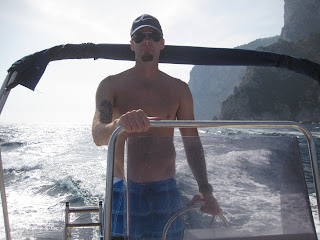 Driving the boat around the island of Capri.