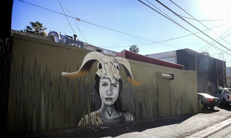 French Street Artist Liliwenn paints a new mural on the streets of Los Angeles, USA 1