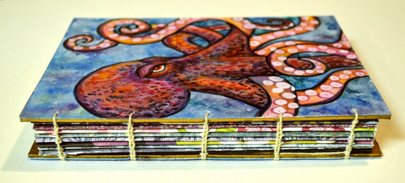 https://www.etsy.com/listing/181338970/handpainted-octopus-journal-sketchbook