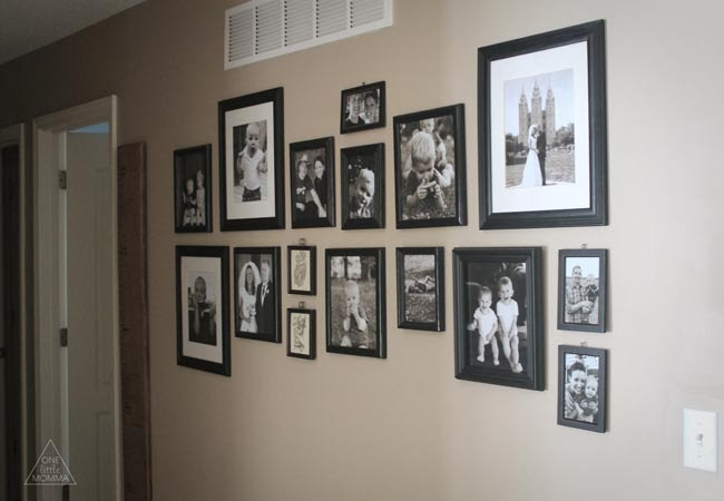 Black and white hallway photo gallery tutorial- this easy and inexpensive project can add a lot of character to an empty wall!