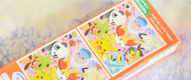 Close-up of the cute print on the back of the box of Pokemon-themed Pocky-like biscuit sticks.