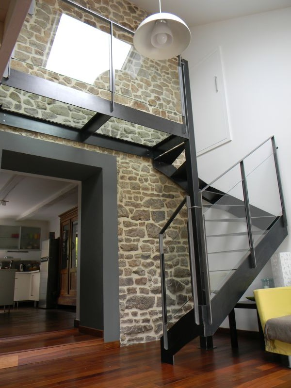 Le top 10 des escaliers design en colima on et h licoidaux for Cage escalier design