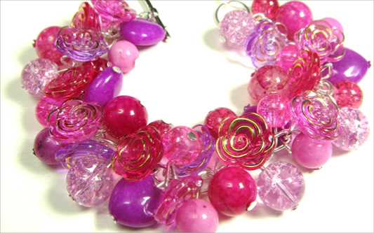 Dramatic bracelet has stunning pink flower buttons with Jade and Dragons Vein Agate beads