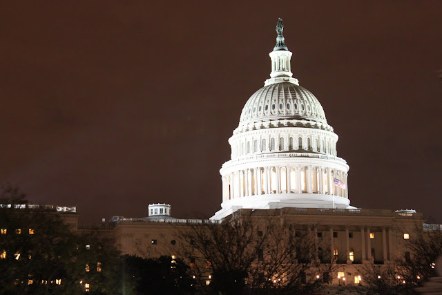 A close view of the US Capitol Dome at night in Washington DC, USA