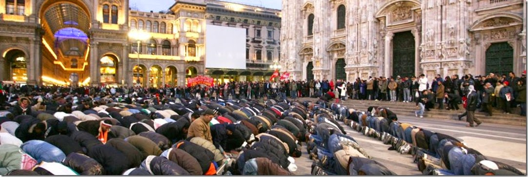 Muslims praying in Piazza del Duomo, Milan, Italy