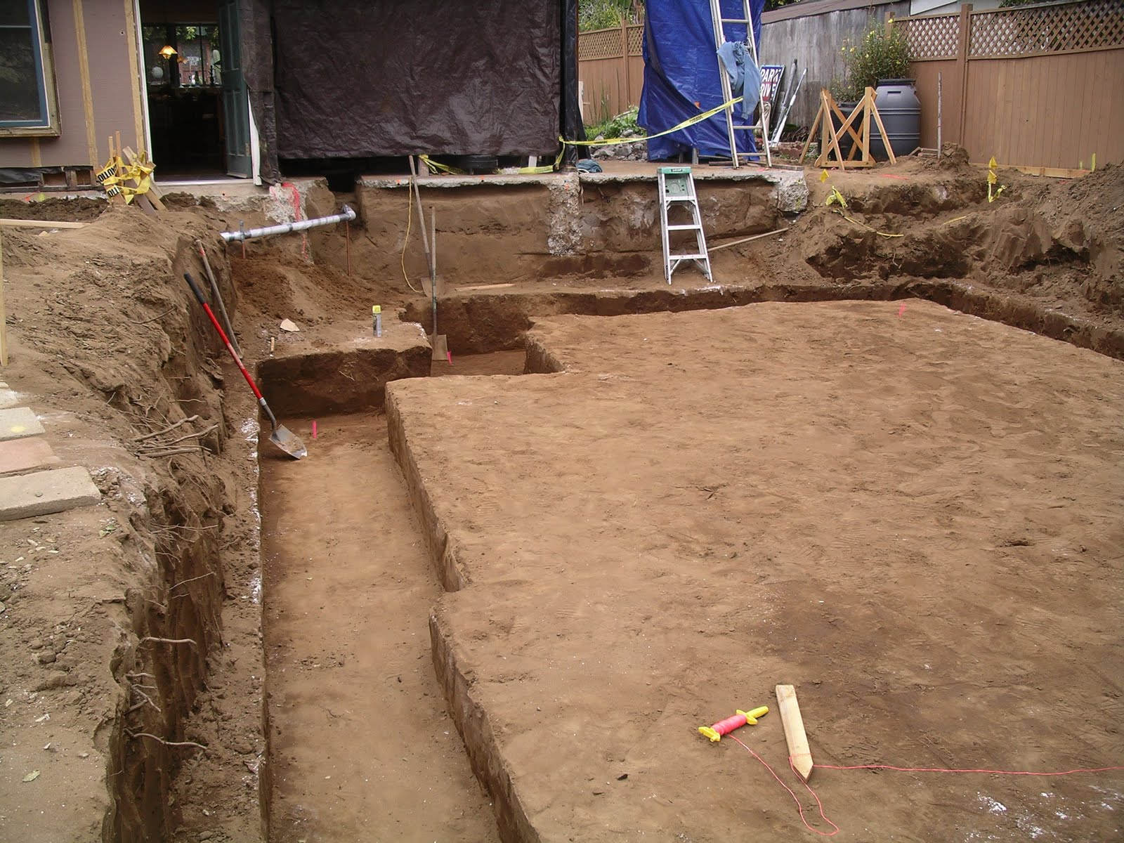 Home remodeling step by step step 8 digging the footing for Digging foundation for house