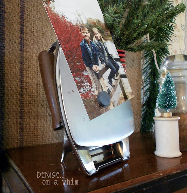 Vintage Iron as a Photo Holder in a Christmas Vignette via http://deniseonawhim.blogspot.com