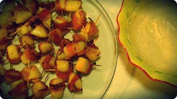 ... Bacon Wrapped Potato Bites with a Spicy/Smokey Sour Cream Sauce For