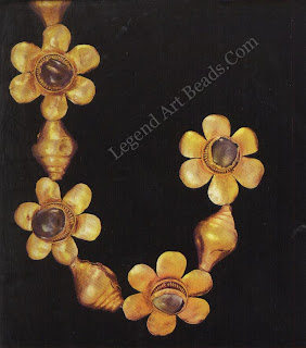 A rare surviving piece of early Indian jewellery, a portion of a gold and sapphire bracelet, it Bihar, eastern India, 1st-2nd century AD. The flowers are linked by cowry shells, an ancient fertility symbol.