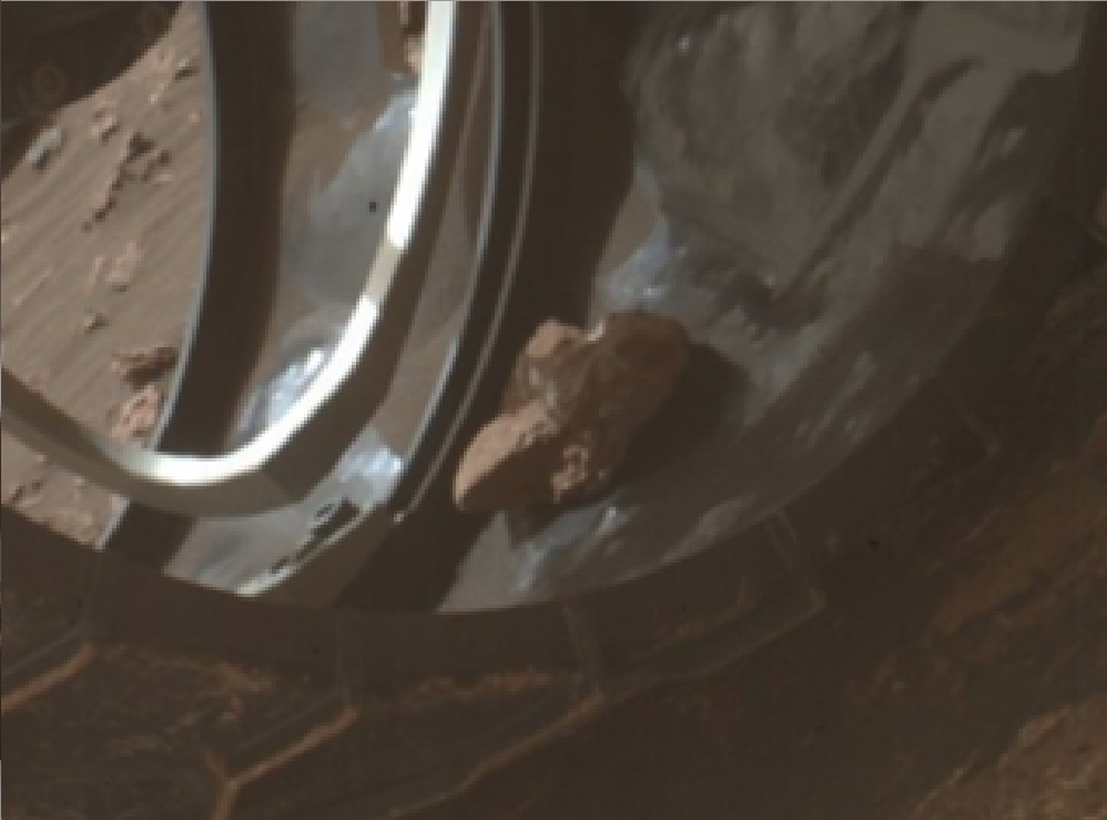 THE CURIOSITY ROVER IS SCRAPING A ROCK
