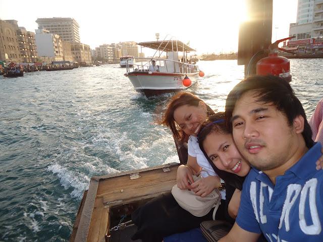 Pose while riding the Abra in Dubai Creek